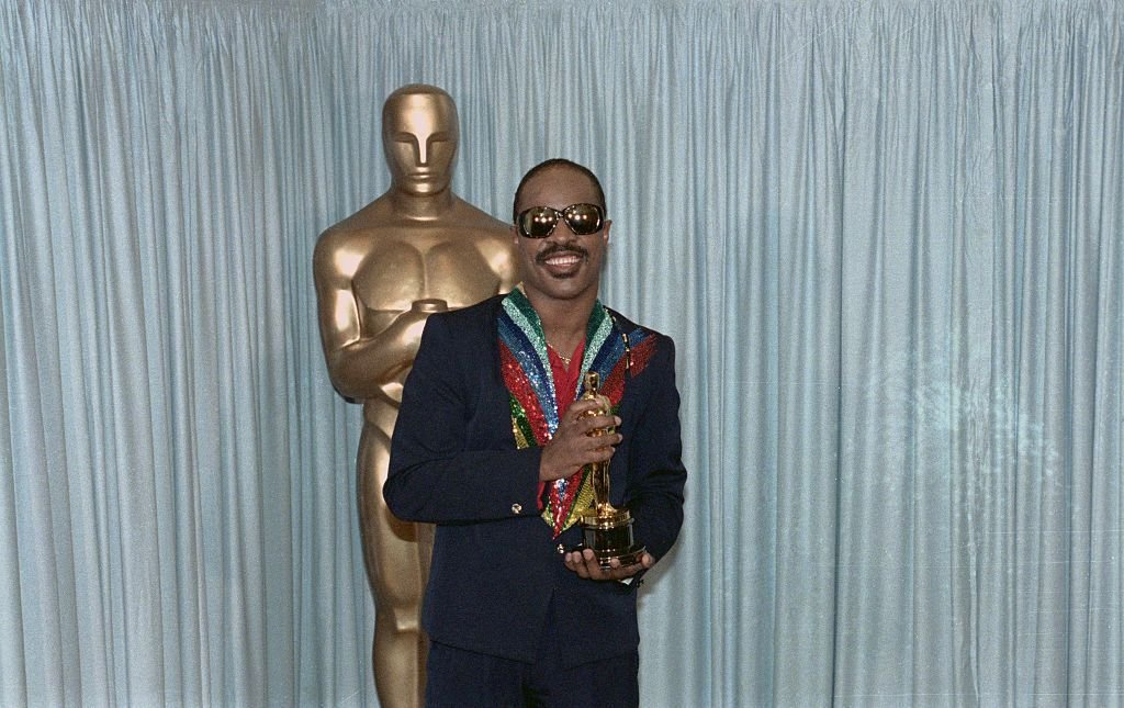 Stevie Wonder holds his Oscar award for the category of Best Song. | Source: Getty Images