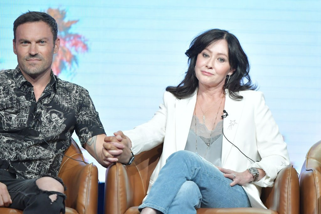 Brian Austin Green and Shannen Doherty hold hands as they speak during the Fox segment of the 2019 Summer TCA Press Tour, at The Beverly Hilton Hotel, on August 7, 2019, in Beverly Hills, California | Source: Amy Sussman/Getty Images
