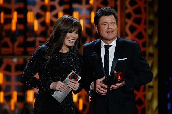 Marie Osmond (L) and Donny Osmond accept the Pop Culture Award onstage during the 2015 TV Land Awards at Saban Theatre on April 11, 2015, in Beverly Hills, California. | Source: Getty Images.