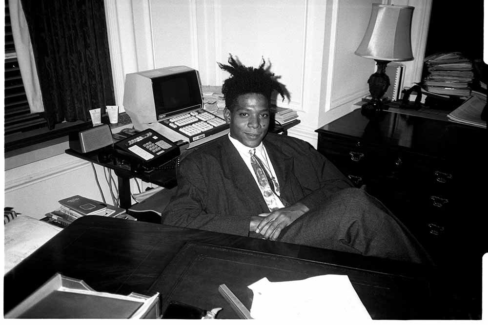Jean - Michel Basquiat at the surprise birthday party for Susanne Bartsch at the Rainbow Roof, at Steven Greenberg's office, 30 Rockefeller Plaza. Thursday, September 19, 1985. I Image: Getty Images.