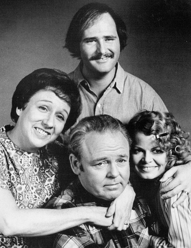 "Cast photo from ""All In the Family"" Back: Rob Reiner (Mike Stivic). Front, from left: Jean Stapleton (Edith Bunker), Carroll O'Connor (Archie Bunker), Sally Struthers (Gloria Bunker Stivic). 