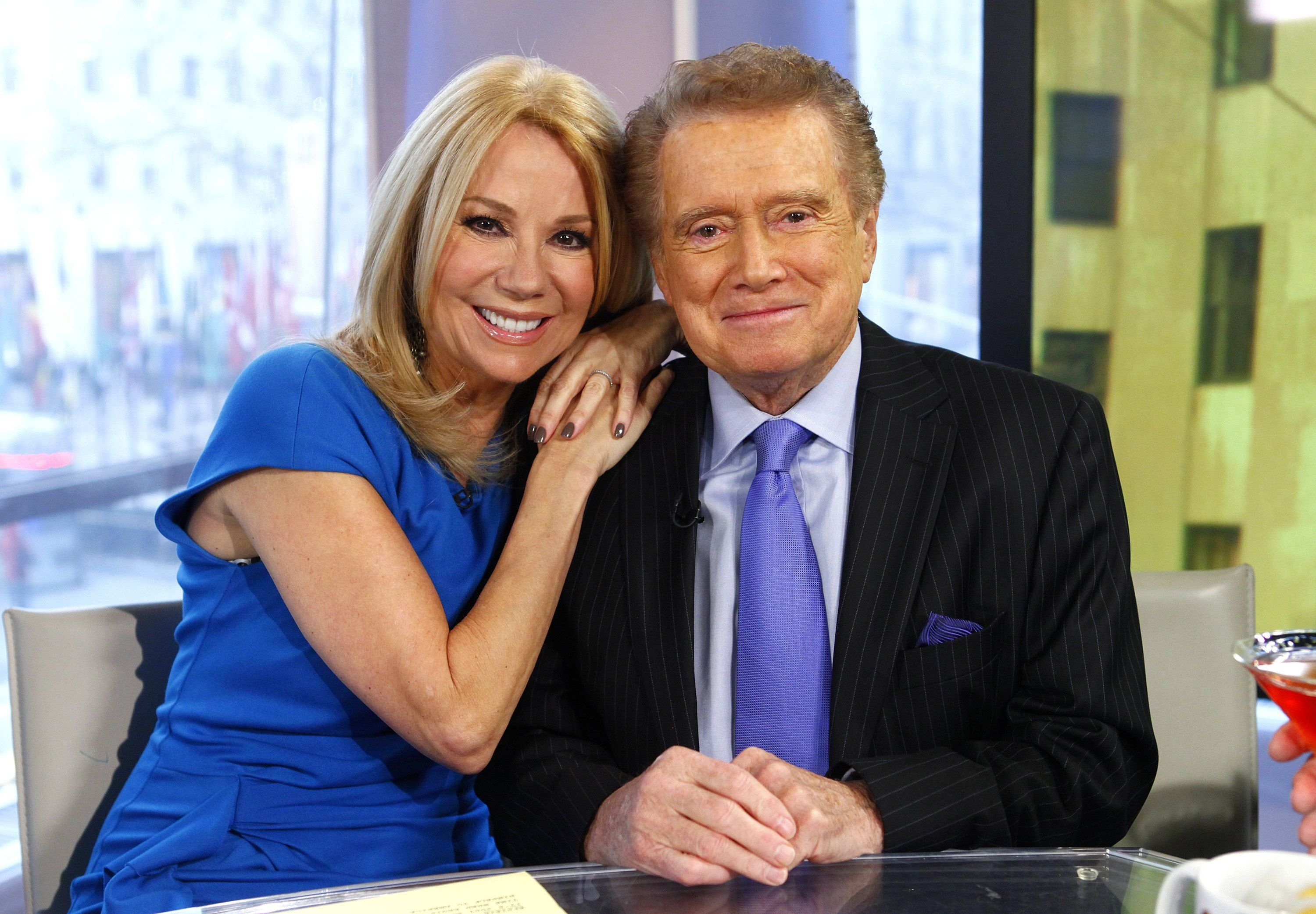 "Television hosts Kathie Lee Gifford and Regis Philbin hugging during a segment of NBC News' ""Today Show"" 
