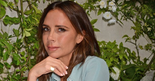 Victoria Beckham Poses on a Ladder in Tight PVC Pants & High Heels — Fans Mock Her Look
