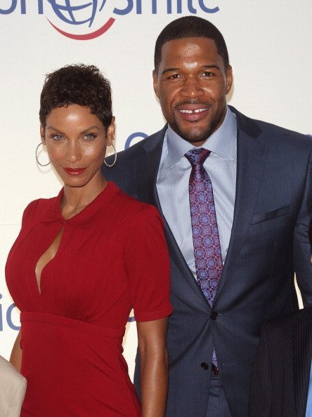 Nicole Murphy and tv personality Michael Strahan attend the Operation Smile's Smile Event at Cipriani Wall Street on May 1, 2014 | Photo: Getty Images