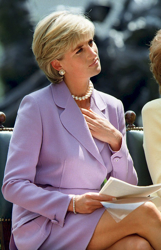 Diana, Princess of Wales, listens to speaker Ken Rutherford at Red Cross headquarters in Washington DC Photo: Getty Images