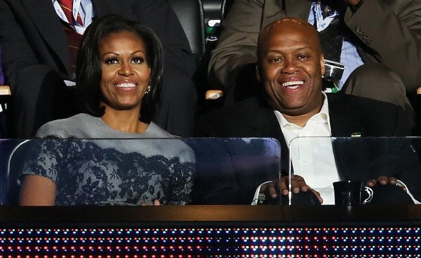 Michelle Obama sits with her brother Craig Robinson in a box during day two of the Democratic National Convention at Time Warner Cable Arena on September 5, 2012, in Charlotte, North Carolina. | Source: Getty Images.