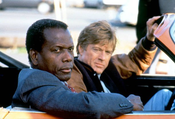 """Sidney Poitier and Robert Redford on the set of the film """"Sneakers."""" 
