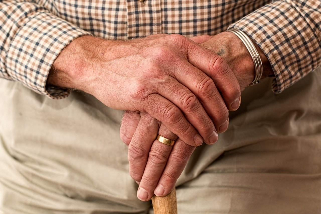 The hands of an elderly man holding a cane. | Image: Pixabay.