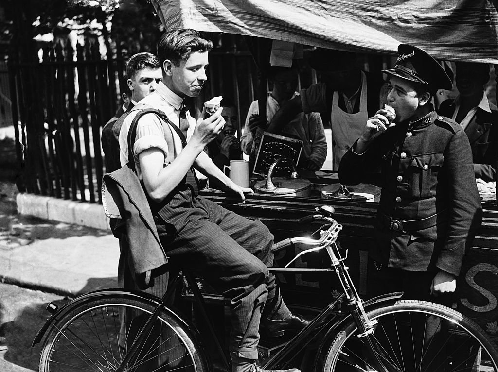 A young cyclist having ice cream during the 1932 heatwave   Source: Getty Images