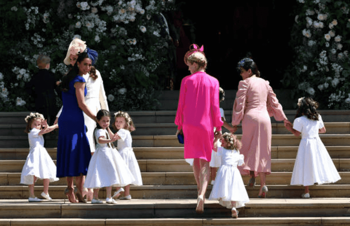 Princess Charlotte, Kate Middleton, Jessica Mulroney, Ivy Mulroney, Florence van Cutsem, Zoe Warren, Zalie Warren, Benita Litt, Remy Litt and Rylan Litt walk up the church steps as they arrive for Prince Harry and Meghan Markle's wedding at St George's Chapel, on May 19, 2018, in Windsor, England | Source: Ben Stansall - WPA Pool/Getty Images