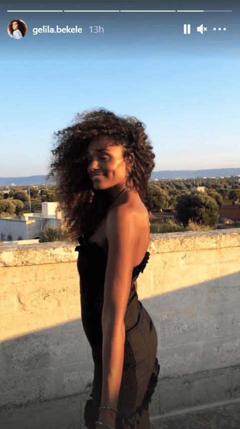 Gelila Bekele in a photo flaunting her hair and dimple in a black dress.   Photo: Instagram/gelila.bekele