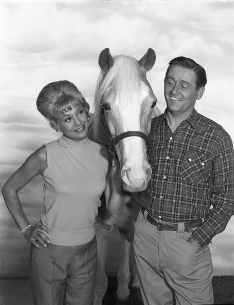 "Connie Hines and Alan Young pose for a cast portrait for the CBS sitcom ""Mister Ed"" in 1964. 