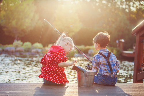 A girl and a boy fishing. | Source: Shutterstock.