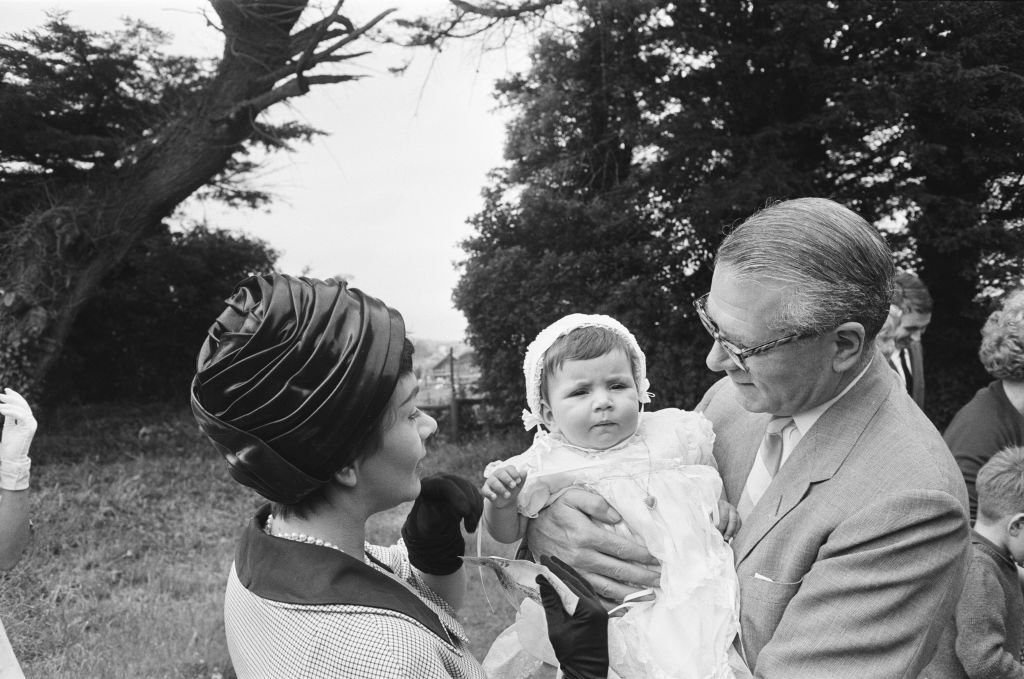 Laurence Olivier and Joan Plowright attend the Christening of their daughter Tamsin on July 14, 1963 | Photo: Getty Images