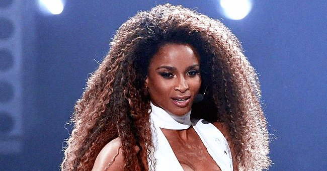 Ciara Displays Her Curves & Wavy Hair Sporting a Lemon Yellow Tracksuit in a New Photo