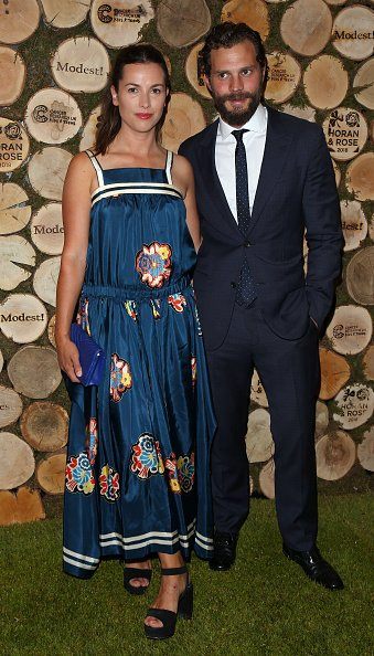 Amelia Warner and Jamie Dornan at The Grove on June 23, 2018 in Watford, England. | Photo: Getty Images