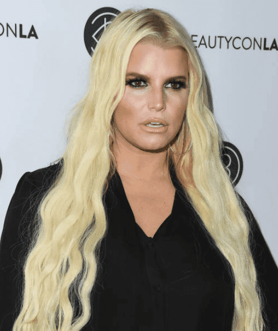 Jessica Simpson poses for cameras at the Beautycon Festival LA, at Los Angeles Convention Center, on July 14, 2018, in Los Angeles, California | Source Getty Images (Photo by Jon Kopaloff/FilmMagic)