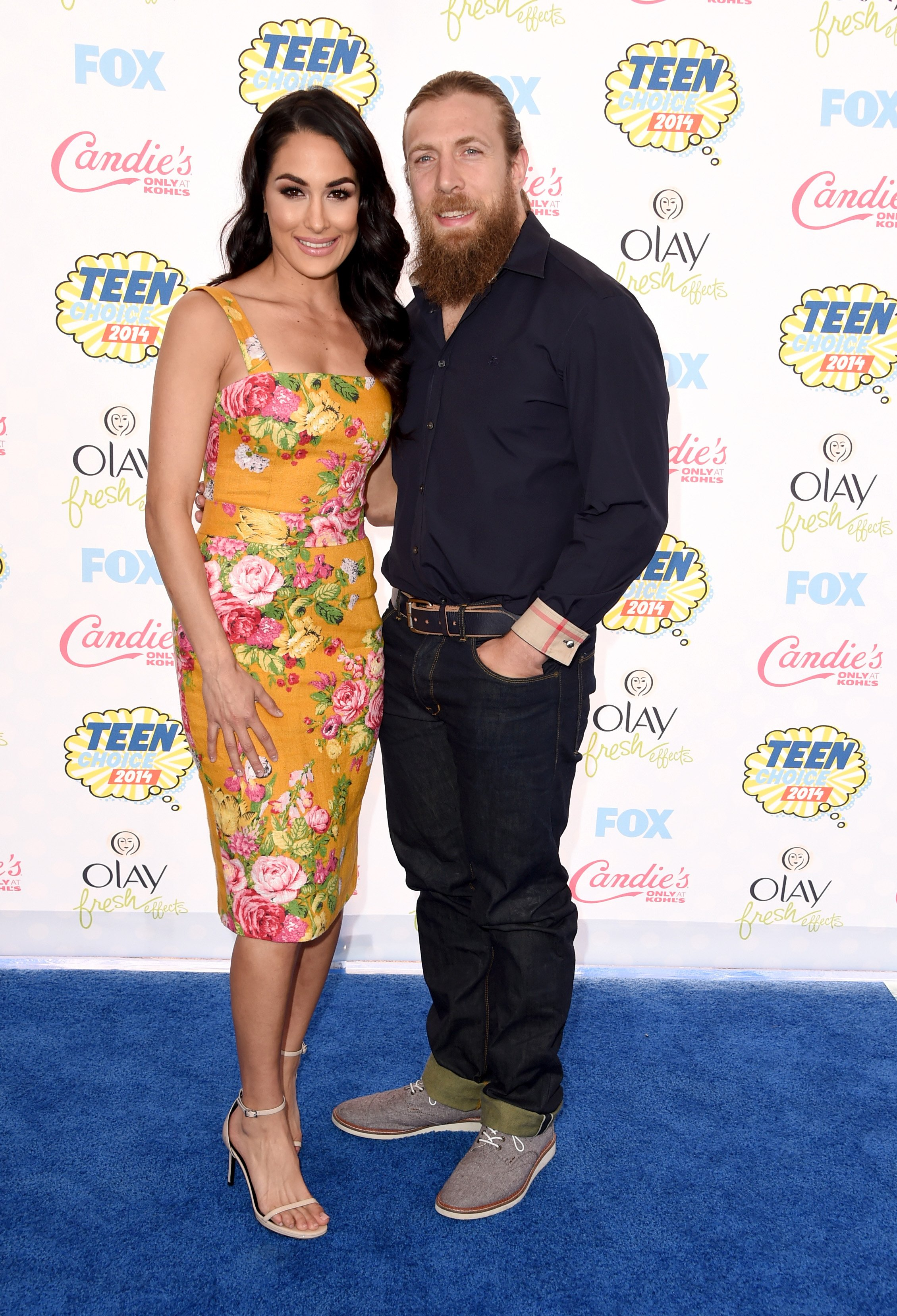 Brie Bella and WWE Superstar Daniel Bryan attend FOX's 2014 Teen Choice Awards on August 10, 2014, in Los Angeles, California. | Source: Getty Images.