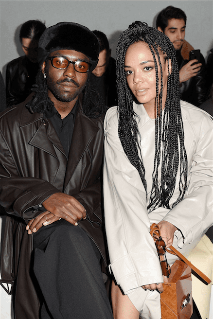 Dev Hynes and Tessa Thompson attend the Bottega Veneta fashion show during the Milano Fashion Week Fall / Winter 2020 - 2021 on February 22, 2020 in Milan, Italy. | Source: Getty Images