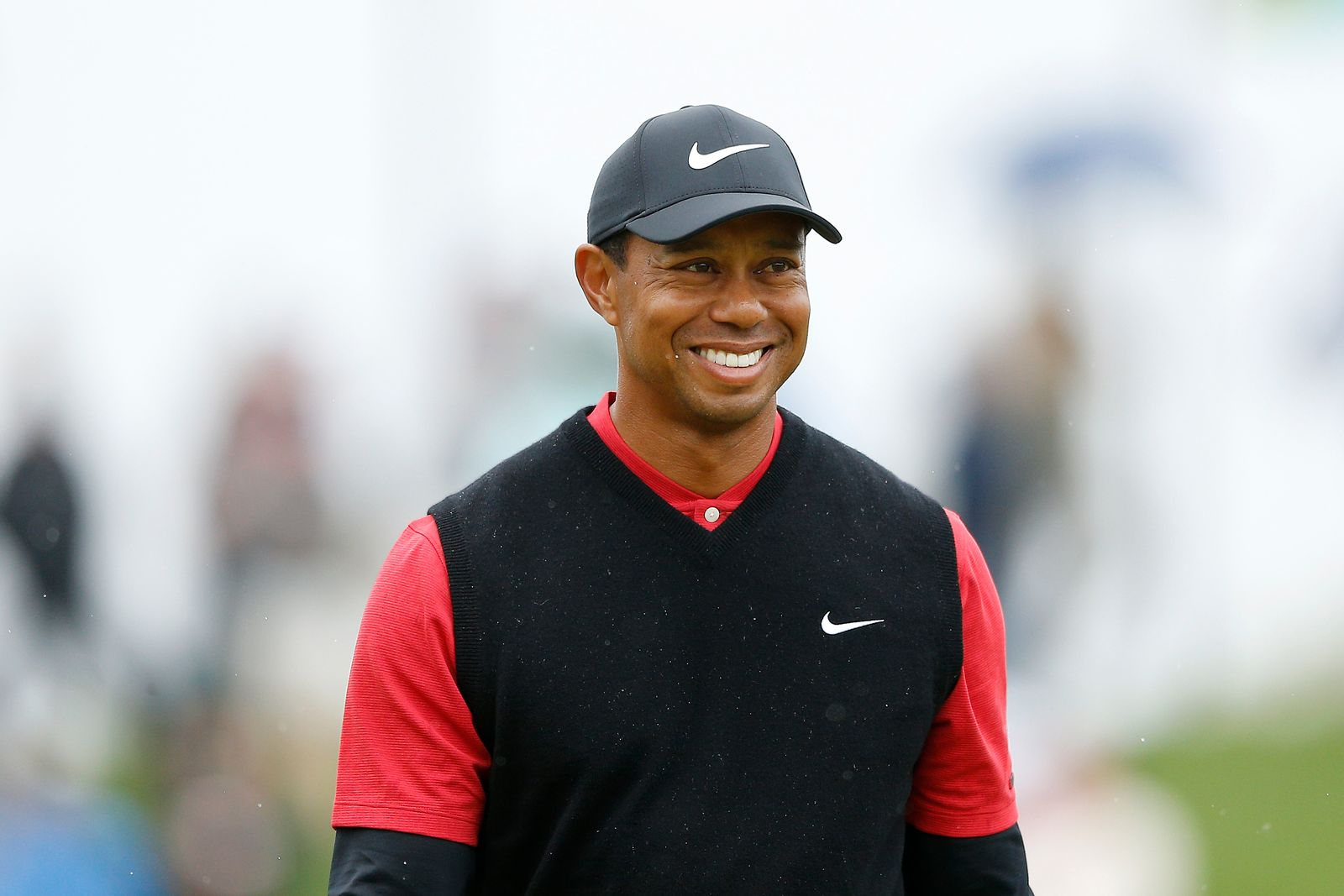 Tiger Woods' reaction after chipping in from the bunker on the third hole during the final round of The PLAYERS Championship at TPC Sawgrass on March 17, 2019. | Source: Getty Images