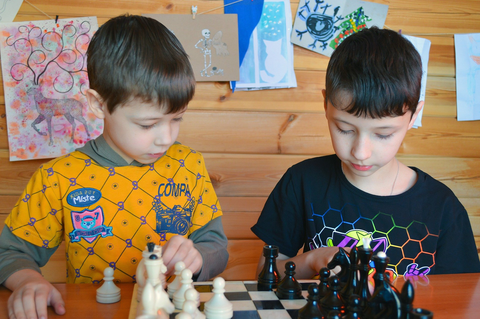 Pictured - Two young boys playing chess   Source: Pixabay