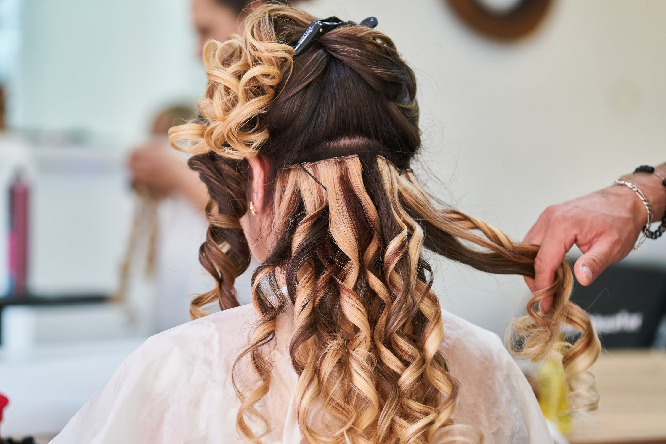 Styling a model's hair | Source: Pexels