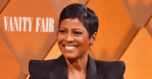 Tamron Hall's Son Moses Enjoys Walking His Pet Dog in a Grassy Area – See the Adorable Photo