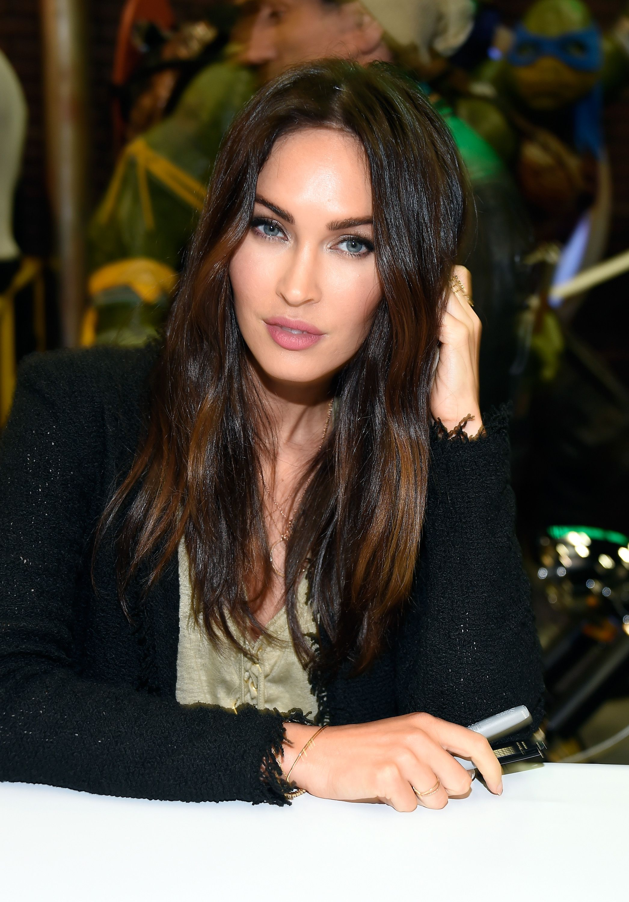 "Megan Fox attends an autograph signing at WonderCon 2016 to promote the upcoming release of Paramount Pictures' ' ""Teenage Mutant Ninja Turtles"" on March 25, 2016 in Los Angeles, California. 