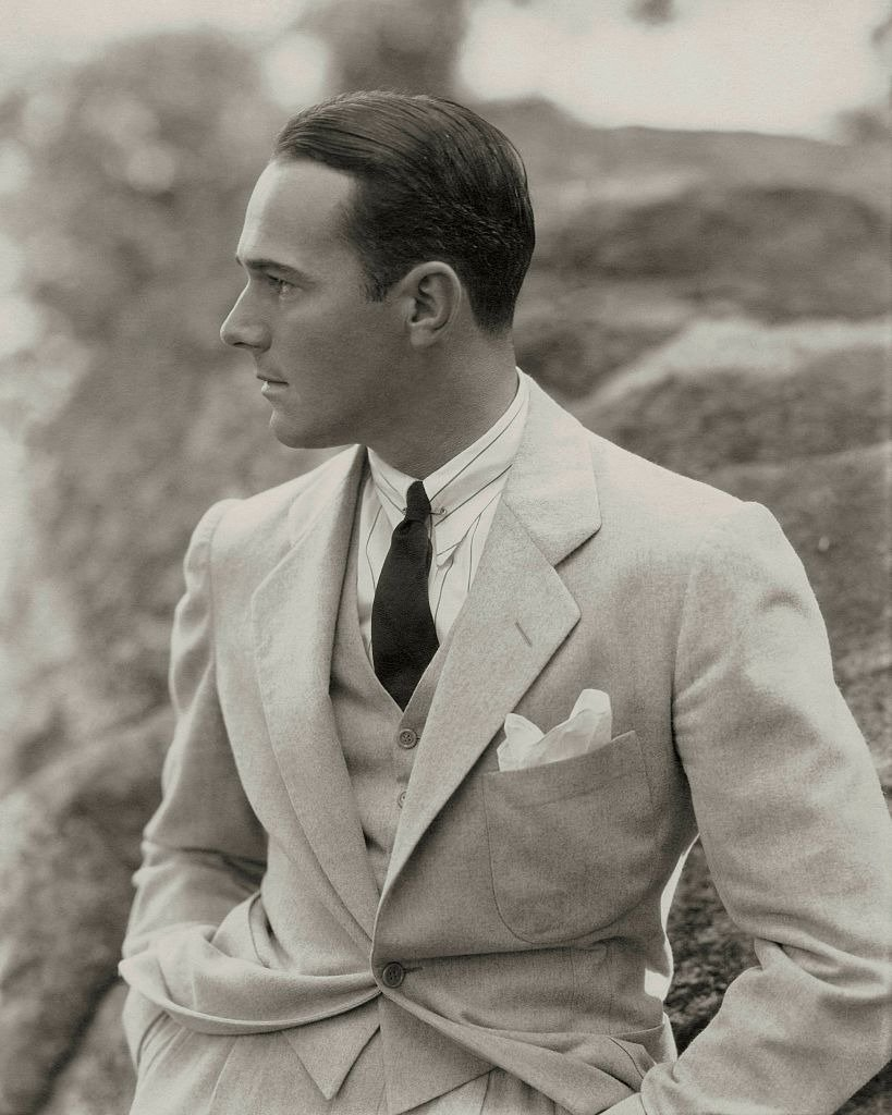 A portrait of William Haines wearing a three piece flannel suit circa 1930. | Photo: Getty Images