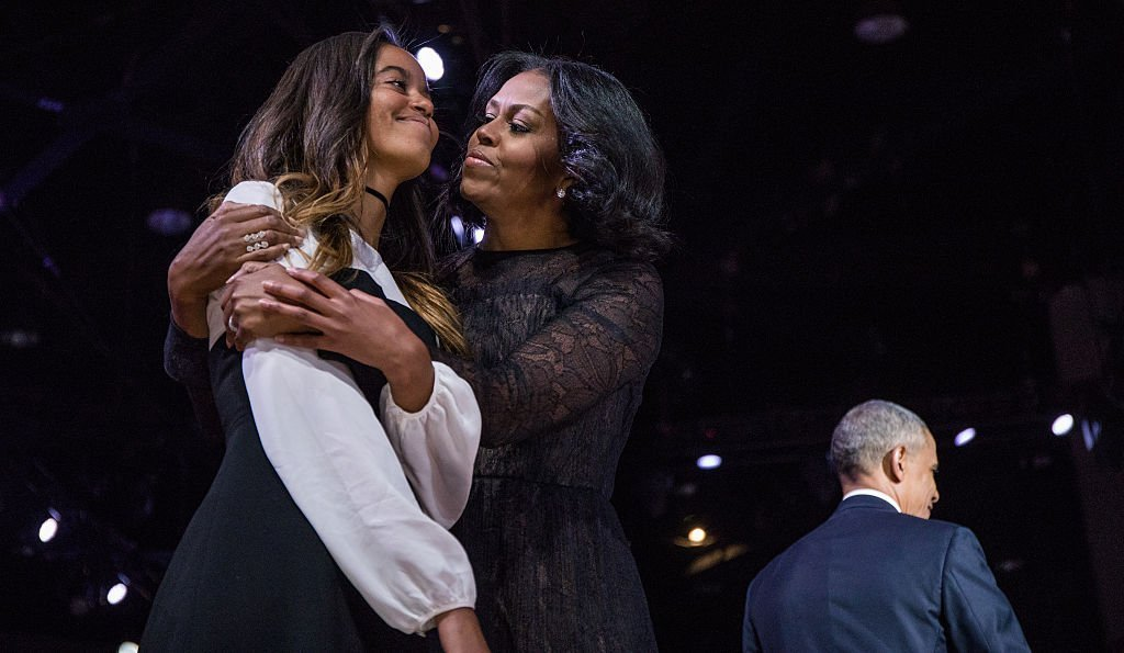 President Obama is joined by Michelle and Malia after his farewell address at McCormick Place in Chicago | Photo: Getty Images