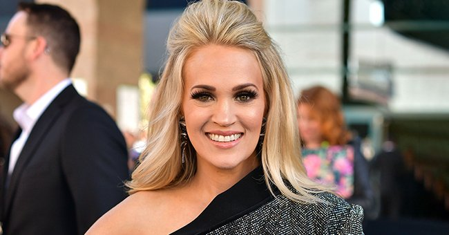 Carrie Underwood Dazzles in Dress with a High Slit at CMA Awards Alongside Husband Mike Fisher