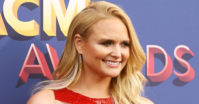 Check Out Miranda Lambert in This Gorgeous Black Fringed Mini Dress and High Cowboy Boots