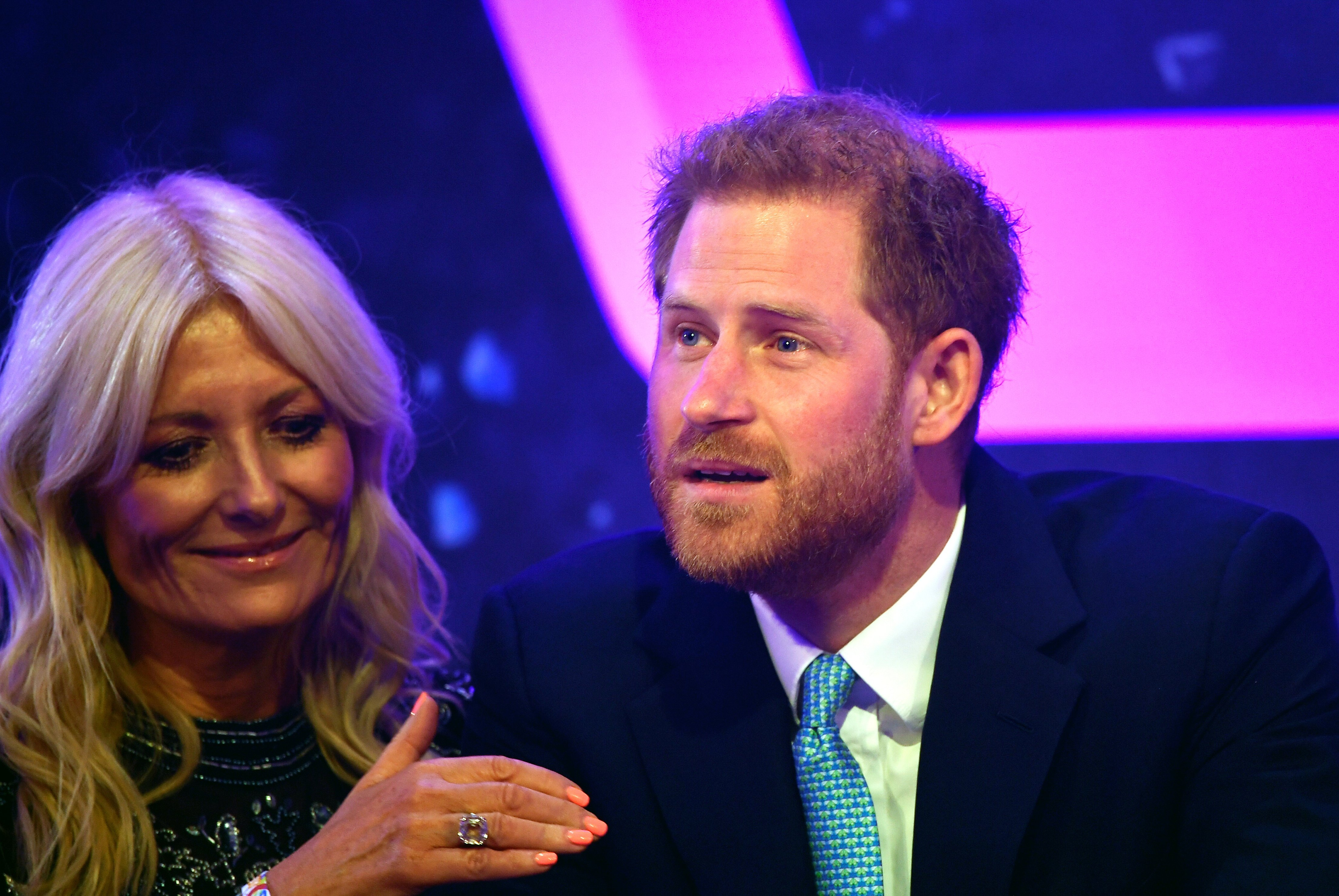 Prince Harry, Duke of Sussex reacts next to television presenter Gaby Roslin as he delivers a speech during the WellChild awards at Royal Lancaster Hotel on October 15, 2019 in London, England | Photo: Getty Images