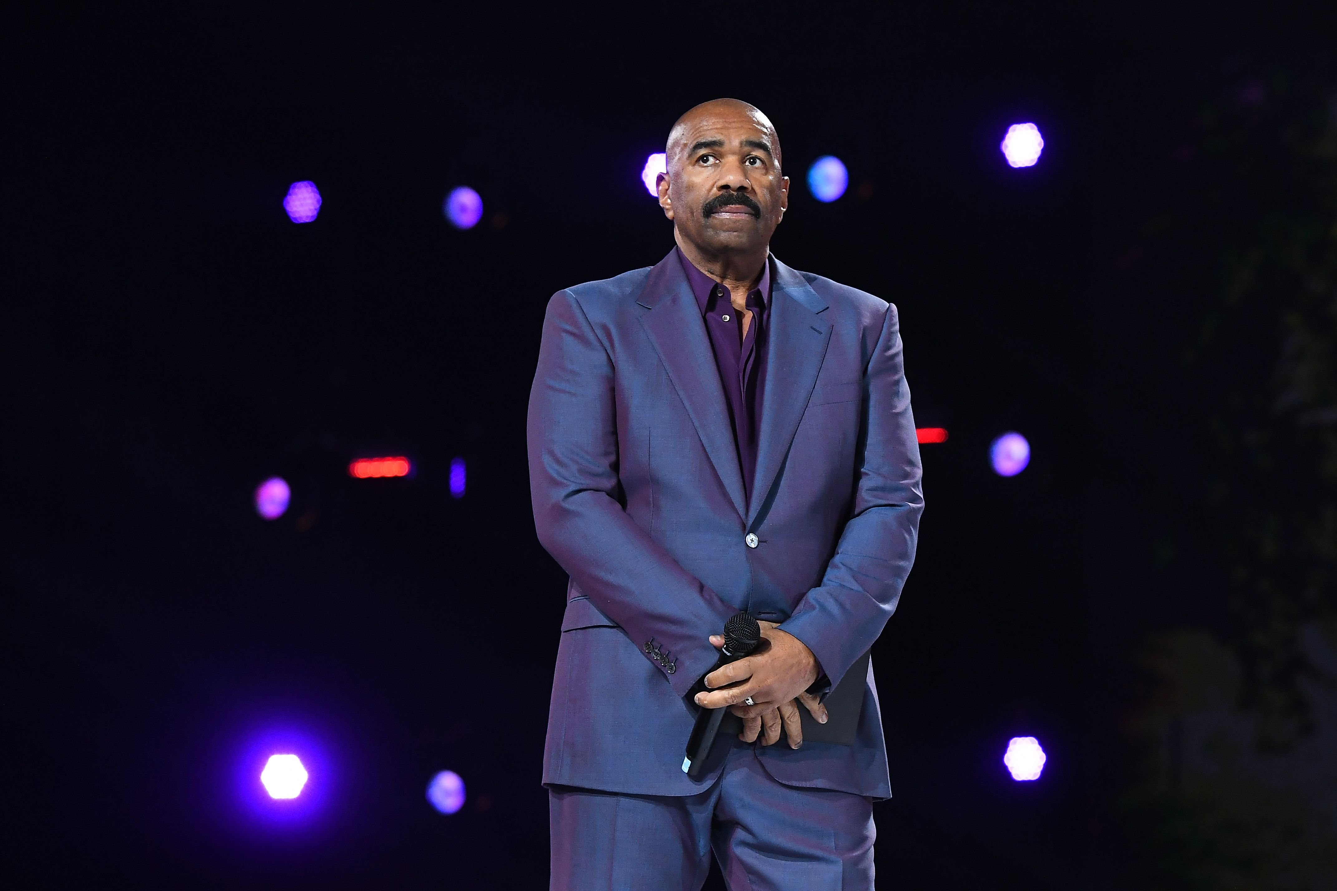 """""""Famiy Feud"""" host Steve Harvey onstage during the Beloved Benefit at Mercedes-Benz Stadium in Atlanta, Georgia 