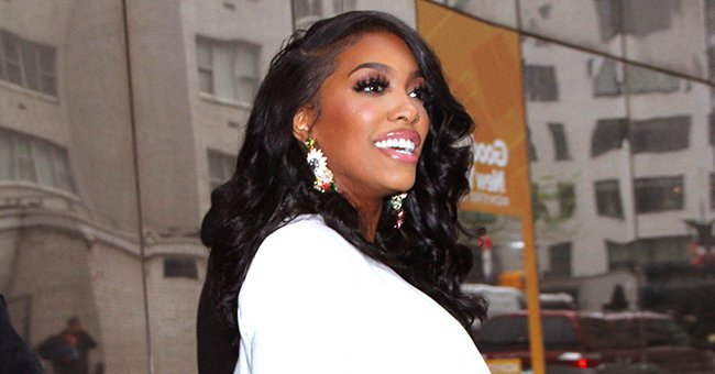 Porsha Williams of RHOA Turns Heads with Her Short Hairdo Posing in a Gray Sweater & Leggings