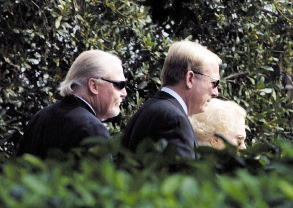 Stacy and James Keach, with mother Mary Cain Peckham, at the funeral of actor Stacy Keach Sr., February 2003   Source: Getty Images