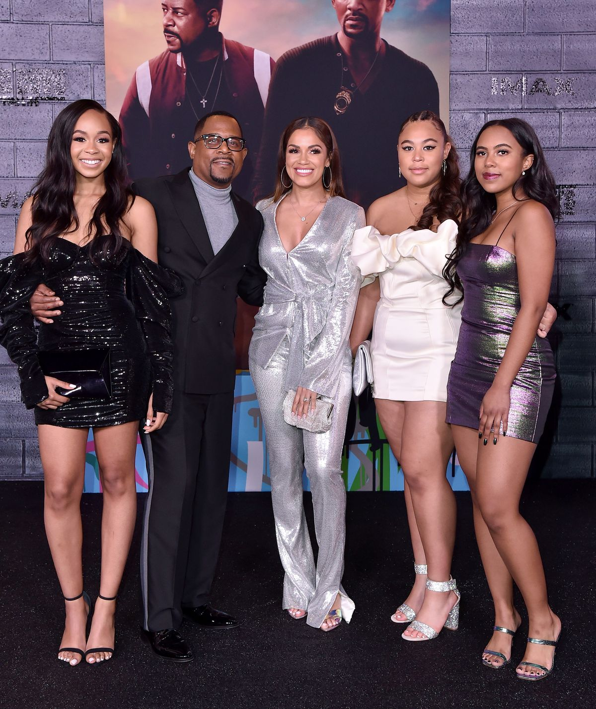 """Martin Lawrence attends the premiere of """"Bad Boys For Life"""" with Roberta Moradfar (in the silver pantsuit) and his 3 daughters in Hollywood, California. January 14, 2020. 