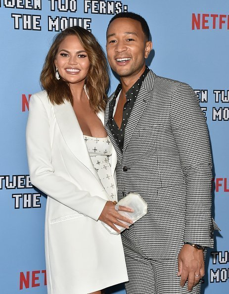 """Chrissy Teigen and husband, John Legend at the LA Premiere of Netflix's """"Between Two Ferns: The Movie"""" in September 2019. 