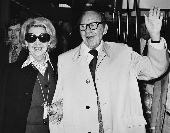 Jack Benny (1894 - 1974) and his wife, actress Mary Livingstone (1908 - 1983) at London Airport  on 12th June 1973 | Photo: Getty Images
