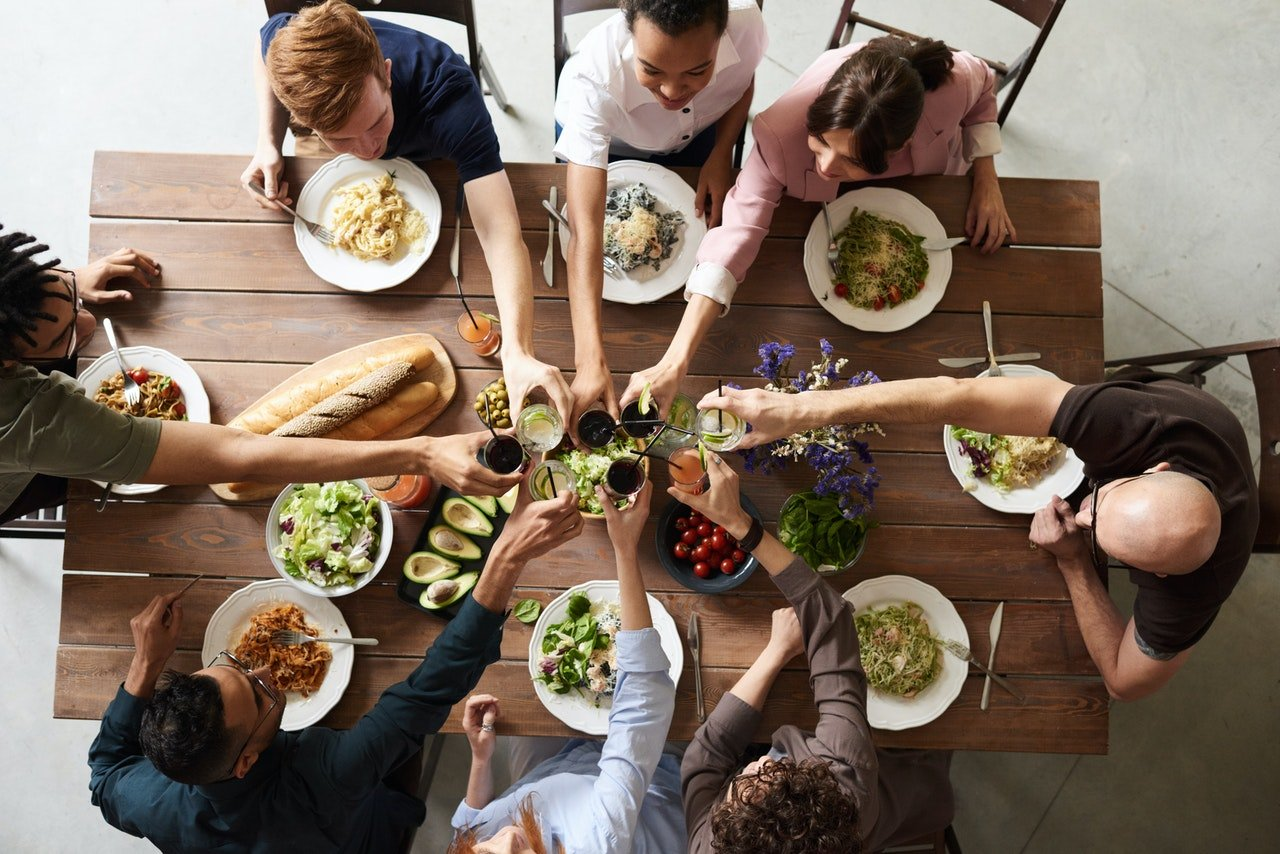 Family sitting together for lunch | Source: Pexels