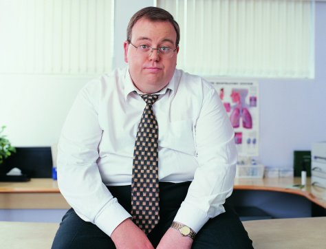 Photo of an overweight businessman in a doctor's office | Photo: Getty Images