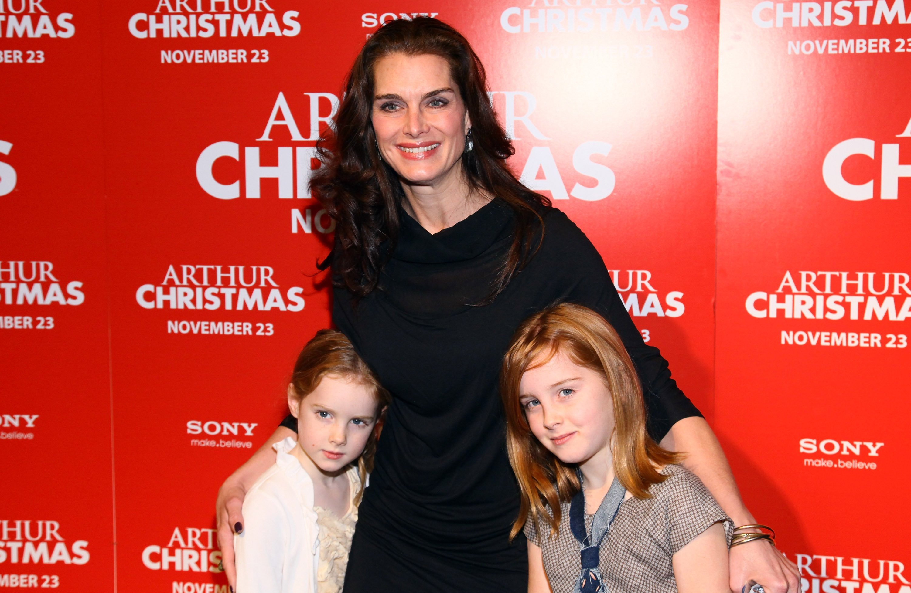 "Brooke Shields, Grier Hammond Henchy and Rowan Francis Henchy attend the ""Arthur Christmas"" premiere at the Clearview Chelsea Cinemas on November 13, 2011, in New York City. 