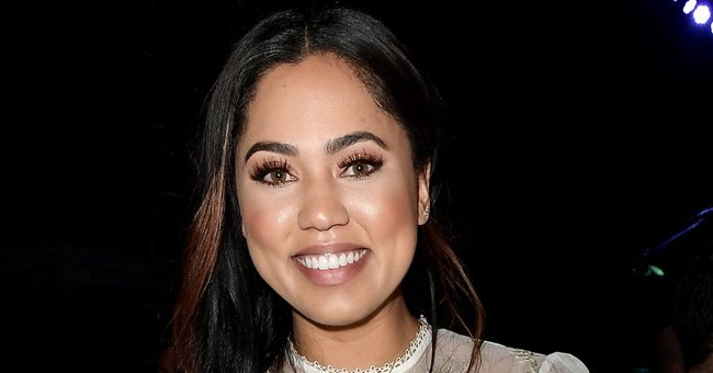Ayesha Curry Flaunts Her Fit Figure in Orange Dress Posing with Husband Steph in Romantic Photo