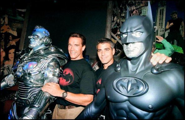 """The stars of the film """"Batman & Robin,"""" actors Arnold Schwarzenegger (L) and George Clooney (R) pose with their costumes Mr. Freeze and Batman 06 June at Planet Hollywood in Beverly Hills  