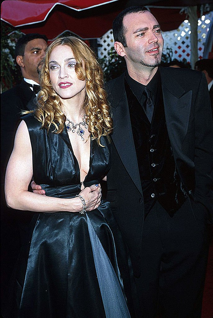 Madonna and Christopher Ciccone during The 70th Annual Academy Awards - Red Carpet at the Shrine Auditorium | Photo: Getty Images