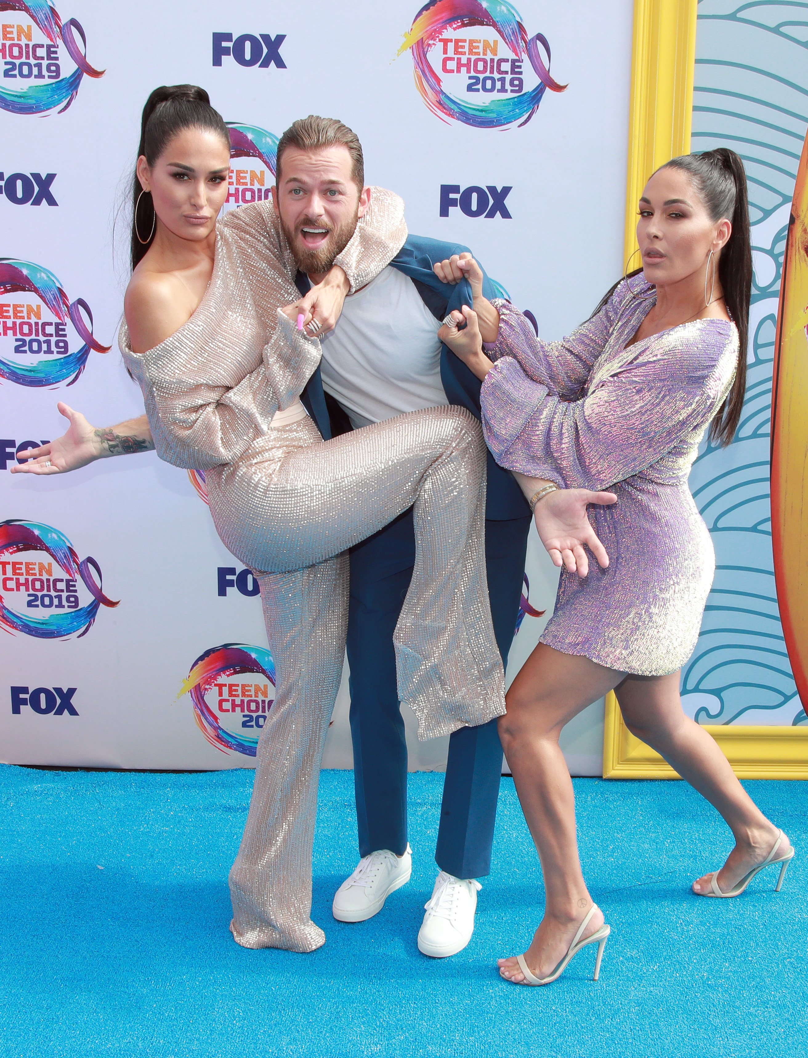 Nikki Bella and fiance Artem Chigvintsev with twin sister Brie Bella during a 2019 event in Santa Monica.   Photo: Getty Images