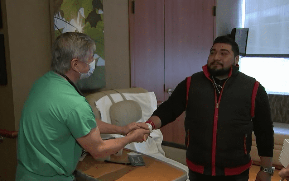 Jason Barbosa meeting Dr. Jeffrey Huml who saved his life for the first time.   Photo: YouTube/ABC 7 Chicago