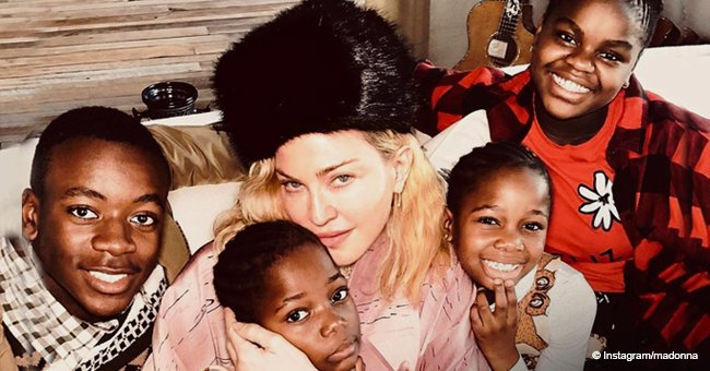 Madonna cuddles up next to her Malawi children in Christmas photo
