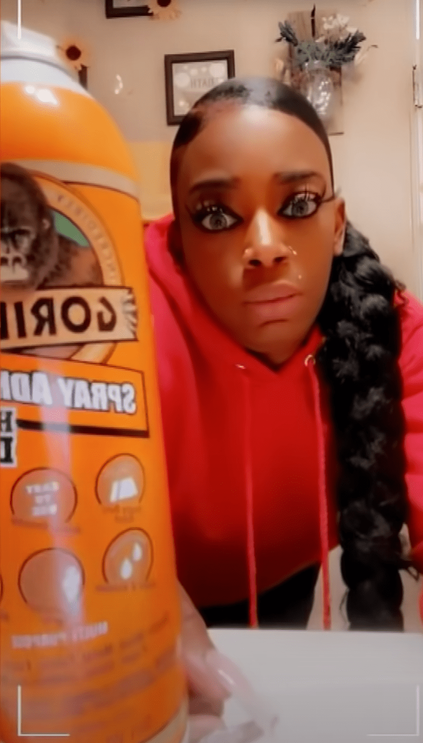 Tessica Brown holding a can of Gorrilla Glue. | Source: Youtube/Inside Edition