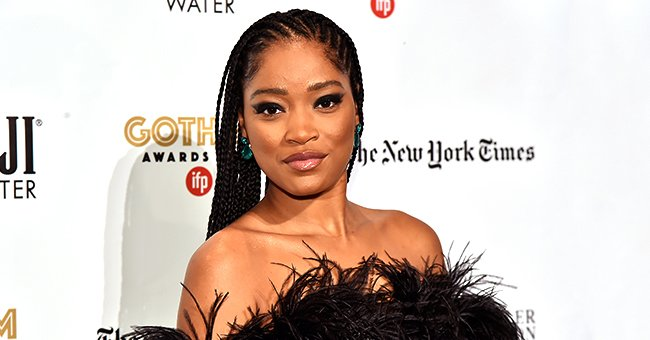 Keke Palmer from GMA Bares Shoulders & Legs in Black Feathered Dress on Red Carpet at 2019 Gotham Awards